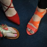 Before they present, the girls at the heart of the video story show off their shoes