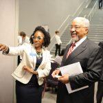 ProKids staff member Raynal Moore guides ProKids Board Member James H. Powell, M.D.