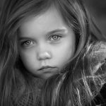 black and white portrait of a beautiful young girl with long hair taken outside