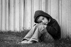 Sad homeless boy